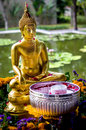 Buddha statue with water bowl Royalty Free Stock Photo