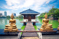 Buddha statues in front of Seema Malaka temple in Colombo
