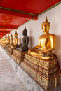 Buddha statues made of gold and black brass Stock Photography