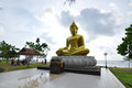 Buddha status shining with sky background Royalty Free Stock Images