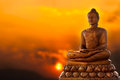 Buddha and sunset in thailand Royalty Free Stock Photo