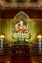 Buddha in tooth relic temple in china town singapore interior Royalty Free Stock Photo