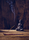 Buddha wood joss stick lit on with Royalty Free Stock Photography