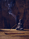 Buddha wood joss stick lit on with Stock Image