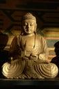 Buddha wood sculpture illuminated by the sun Stock Photo