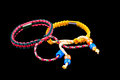 Buddhist bracelets on black background a pair of isolated a Royalty Free Stock Image