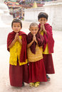 Buddhist children blessing give with hands together wearing red and white religious garments next to boudhanath stupa kathmandu Stock Photography