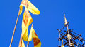 Buddhist flag with pagoda top yellow the dharmacakra symbol of buddhism in thailand Stock Image