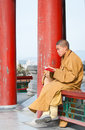 Buddhist monk beijing china – march th praying in pavilion of everlasting spring wanchun ting on a tophill of jingshan park Royalty Free Stock Photo