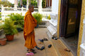 Buddhist Monk entering temple Stock Images