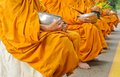 Buddhist monk hold bowl Stock Photography