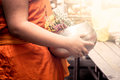 Buddhist monk holdind monk s alms bowl in the temple Royalty Free Stock Photos