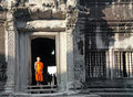 Buddhist monk posing in Angkor Wat temple Royalty Free Stock Photos