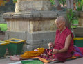 Buddhist monk praying (Bodh Gaya - India) Royalty Free Stock Photo