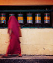 Buddhist monk spinning prayer wheels in mcleod ganj vintage retro effect filtered hipster style travel image of with beads passing Royalty Free Stock Photo