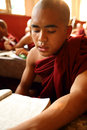 Buddhist monk young burmese studying pali at school in yangon myanmar Stock Photo