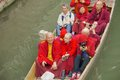 Buddhist monks on holiday to visit a place in cambridge england where a famous poet from china studied hear seen punting on the Stock Image