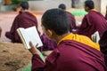 Buddhist monks kushalnagar india june th reading scripture in the monastery at kushalnagar india june th Stock Photos