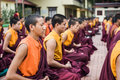 Buddhist monks kushalnagar india june th sitting in meditation in a monastery in kushalnagar india june th Royalty Free Stock Photography