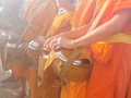Buddhist monks waiting for food offering in the morning Royalty Free Stock Photo