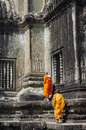 Buddhist monks walking at angkor wat in cambodia Royalty Free Stock Photo