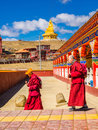 Buddhist monks walking in Yarchen Gar Monastery