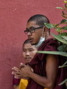 Buddhist monks young in natural pensive mood Royalty Free Stock Image