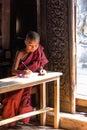 Buddhist novice bagaya monastery is writing near the door Stock Photography