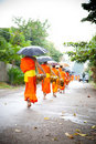 Buddhist novices walk to collect alms Royalty Free Stock Photography