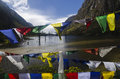 Buddhist prayer flags by the lake Royalty Free Stock Photo