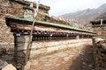 Buddhist prayer many wall with prayer wheels
