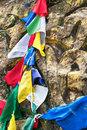 Buddhist prayer stone and praying flags Royalty Free Stock Images
