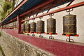 Buddhist prayer wheels at a monastery Royalty Free Stock Images