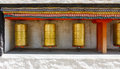 Buddhist prayer wheels at a temple Royalty Free Stock Photo