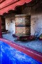 Buddhist prayer wheels in Tibetan monastery with written mantra. India, Himalaya, Ladakh Royalty Free Stock Photo