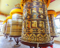 Buddhist prayer wheels in tibetan monastery with written mantra yoksom sikkim india Royalty Free Stock Photos