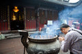 Buddhist prayers burning incense Royalty Free Stock Photo