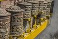 Buddhist prayers in kathmandu nepal rotating cylinders with boudhanath temple Royalty Free Stock Photo