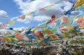 Buddhist praying flags floating in the wind on blue sky Stock Image