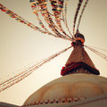 Buddhist shrine Boudhanath Stupa - vintage filter. Stupa with Buddha wisdom eyes. Royalty Free Stock Photo