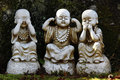 Buddhist statues cute calles see no evil hear no evil speak no evil in japanese temple daisho in miyajima Stock Images