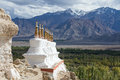 Buddhist stupa and Himalayas mountains in Ladakh, India Royalty Free Stock Photo