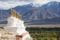 Buddhist stupa and Himalayas mountains . Shey Palace in Ladakh, India Royalty Free Stock Photo