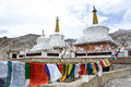 Buddhist stupa and prayer flags in Ladakh, India Royalty Free Stock Photo