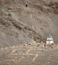 Buddhist stupa and stone swastika cross symbols in the himalayas near lamayuru monastery in ladakh province Stock Image