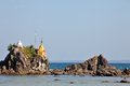 Buddhist stupas on the beach pagodas top of rocks found of ngwe saung west coast of myanmar Stock Photos