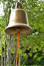 Buddhist wishing bell thailand tradition with green leaves background Royalty Free Stock Image