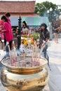 Buddhist worshiping and making religious merit Stock Photos