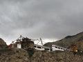 Buddhistic Mani Wall on Dark Monsoon Day Royalty Free Stock Photo
