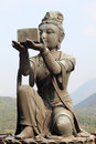 Buddhistic statue in hong kong making offerings to the tian tan buddha Royalty Free Stock Photography